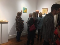 Artist discussing artwork with gallery patrons