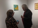"Discussing ""The Oracle"" with a with a gallery patron"
