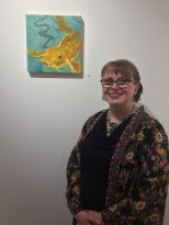 "Elizabeth M. Willey, with her painting ""The Oracle"", which is encaustic mixed media on panel."