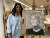 Student Stacey Slaughter with her final class Chiaroscuro drawing