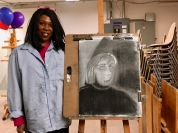 Student Stacey Slaughter with her Low Key Composition drawing
